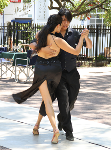 Couple doing Tango in San Telmo, a popular neighborhood in Buenos Aires